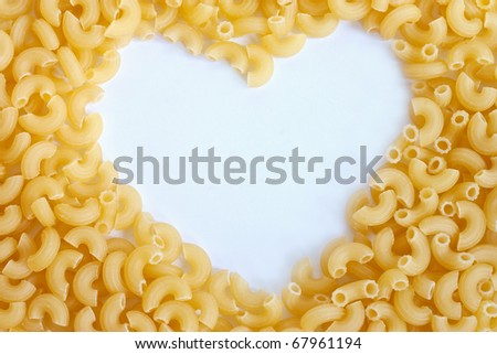 Macaroni pipe form with copy space in heart shape - stock photo