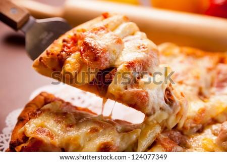 Macaroni pizza, ready to eat - stock photo