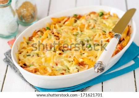 Macaroni, Pumpkin, Chicken and Cheese Pasta Bake in a White Ceramic Dish - stock photo