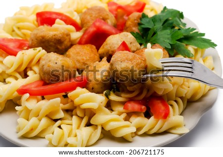 macaroni with meatballs and tomatoes the isolated - stock photo