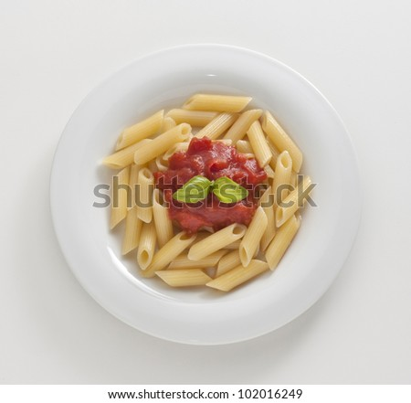 macaroni with tomato and basil on white background