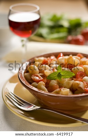 macaroni with tomato sauce and salad in background - stock photo