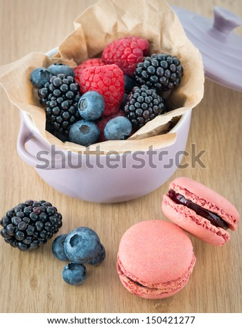 Macarons and berry fruits on the table