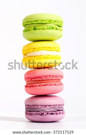 macarons are on top of each other, in the amount of 4 PCs - stock photo