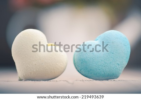 macarons in heart shape on wood table,vintage tone style - stock photo