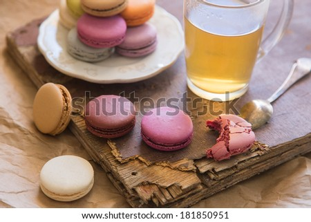 macarons with cup of tea - stock photo