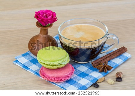 Macaroon delicious with espresso coffee served rose - stock photo