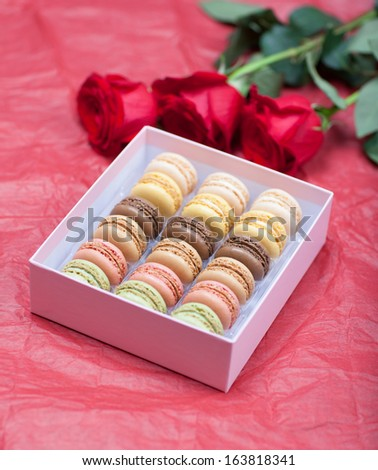 Macaroon on a paper background with roses - stock photo
