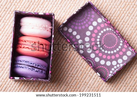 Macaroons in a carton box - stock photo