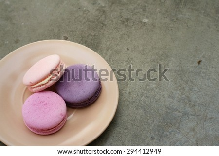 Macaroons on a plate at coffee shop.