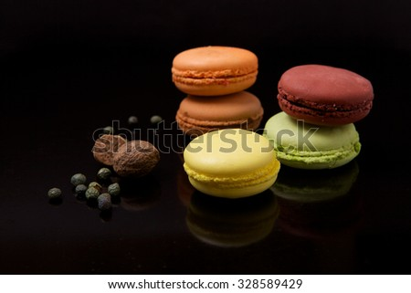 Macaroons on black surface