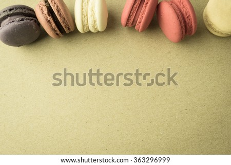 macaroons on craft paper background - stock photo
