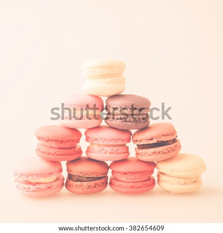 macaroons on craft paper in vintage color style - stock photo