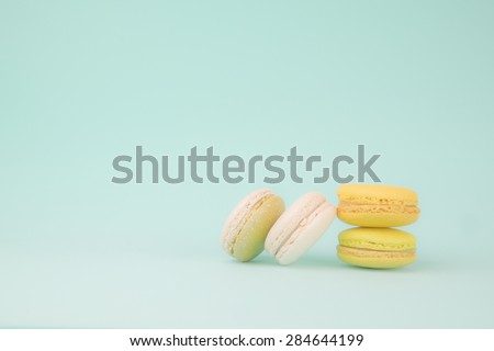 Macaroons on retro vintage background color