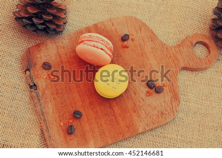 Macaroons on wooden tray with coffee bean