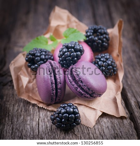 Macaroons with blackberries - stock photo