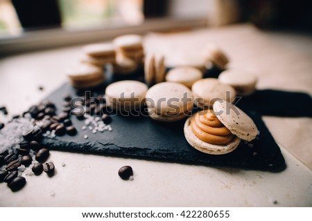macaroons with chocolate, salted caramel and cinnamon - stock photo