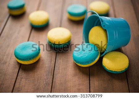 Macaroons with lemon flavor on wooden table