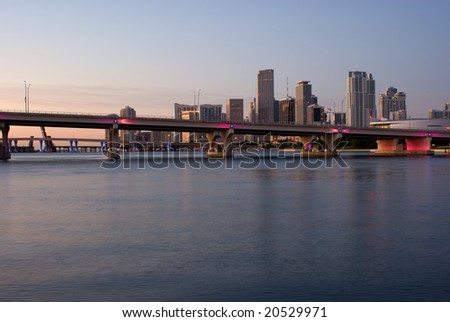 MacArthur Causeway, Harbor Bridges and Miami Bayfront Skyline at Dawn - stock photo