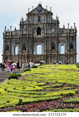 MACAU -4 AUGUST 2013- The ruins of St. Paul's are the relics of a 16th century Roman Catholic church built by the Jesuits in the historic center of Macau (Macao), then a Portuguese colony. - stock photo