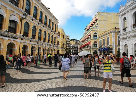 MACAU - AUGUST 1: Tourists are seen visiting the Historic Centre of Macao on August 1, 2010 in Macau, China. The Historic Centre of Macao was inscribed on the UNESCO World Heritage List in 2005. - stock photo