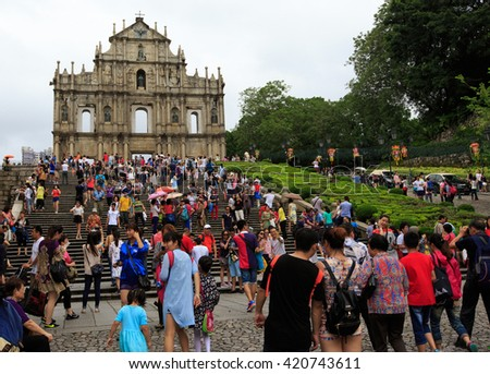 MACAU-AUGUST : Tourists visit the Historic Centre of ruined church of St Paul on August  9, 2015 in Macau, China. The ruined church of St Paul was inscribed on the UNESCO World Heritage List in 2005. - stock photo