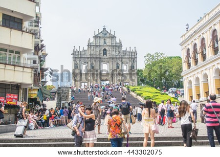 MACAU CHINA - MAY 24: Tourists and local residents walk pass and take photos at the Ruins of St. Paul's in sunny day on May 24, 2016 in Macau, China. - stock photo