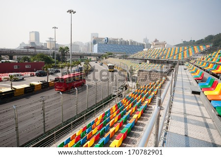 MACAU, CHINA - NOVEMBER 2, 2012: Construction of seats for spectators and preparation track for race Macau Grand Prix in stages Formula 3, FIA WTCC, motorcycle prize. Race takes place on the streets. - stock photo