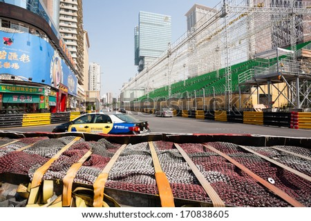 MACAU, CHINA - NOVEMBER 2, 2012: Safety barriers installed along roads before the upcoming racing Macau Grand Prix in stages Formula 3, FIA WTCC, motorcycle prize. Race takes place on the streets. - stock photo