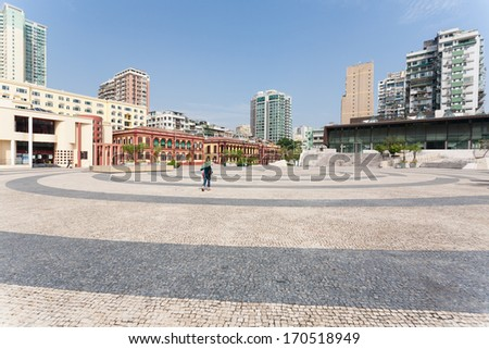 MACAU, CHINA - NOVEMBER 1, 2012: Tap Seac Square lined by the famous Portuguese wavy stone pavers and is surrounded by old buildings. Macau annually visited by about 29 million tourists. - stock photo