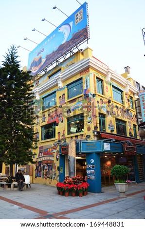 MACAU, DECEMBER 12, 2013: Visitors visit the famous souvenir street in Macau. - stock photo