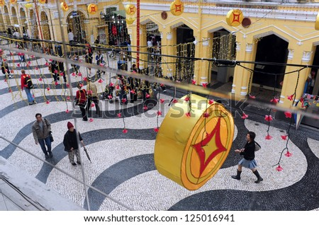 MACAU - FEB 20:Visitors at Macau Historic Center on February 20 2009 in Macau, China.The Historic Center of Macao was inscribed on the UNESCO World Heritage List in 2005. - stock photo