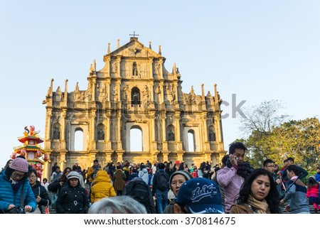 Macau - January 25, 2016: Ruins of St. Paul's. Built from 1602 to 1640, one of Macau's best known landmarks. Part of the Historic Center of Macau, a UNESCO World Heritage Site.Many people visit here. - stock photo