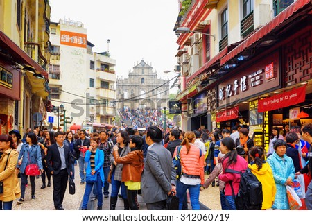 MACAU - JANUARY 30, 2015: The Street leading to the Ruins of St. Paul's Cathedral in the historic centre of Macau. Macau is a popular tourist attraction of Asia in the holidays. - stock photo