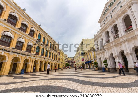 MACAU - JUNE 6, 2014:  Historic Centre of Macao-Senado Square in Macau, China. The Historic Centre of Macao was inscribed on the UNESCO World Heritage List in 2005.  - stock photo