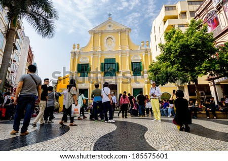 MACAU-MARCH 26 : Tourists visit the Historic Centre of Macao-Senado Square on March 6, 2014 in Macau, China. The Historic Centre of Macao was inscribed on the UNESCO World Heritage List in 2005. - stock photo