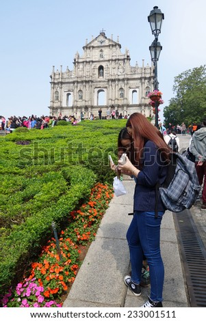 MACAU-NOVEMBER 19 : Tourists visit the Historic Centre of ruined church of St Paul on 19 Novemer 2014 in Macau. The ruined church of St Paul was inscribed on the UNESCO World Heritage List in 2005. - stock photo