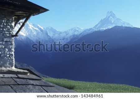 Macchapuchare view from stone building - stock photo