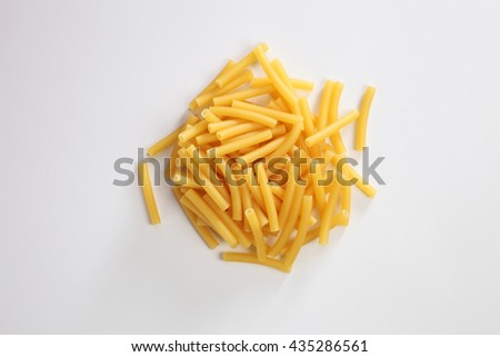 Maccheroni dry pasta on the white background - stock photo