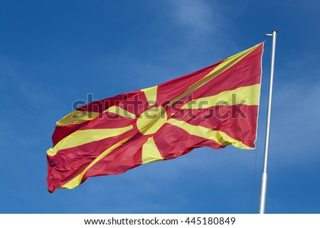 Macedonian flag on the blue sky. On the mast.
