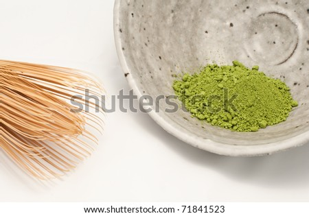 Macha green powder in a bowl, with the whisk - stock photo