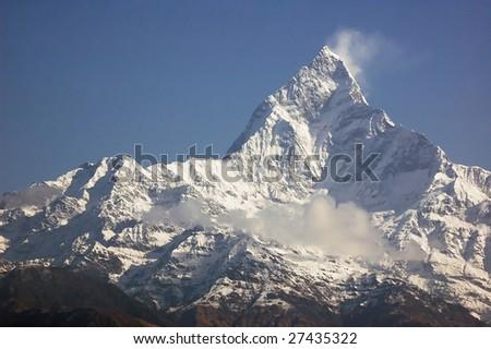 Machapuchare - majestic mountain peak in Himalaya, near Pokhara, Nepal. - stock photo