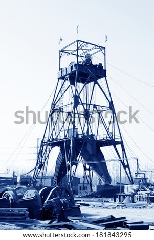 MACHENG - March 13: Drilling derrick in MaCheng iron mine on march 13, 2014, Luannan County, Hebei Province, China  - stock photo