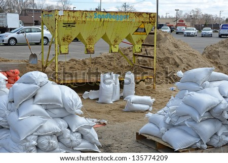 MACHESNEY PARK, IL - APRIL 20:Due to Rock River flooding sandbag loading chutes and sandbags are at the ready. April 20, 2013 Machesney Park, IL - stock photo