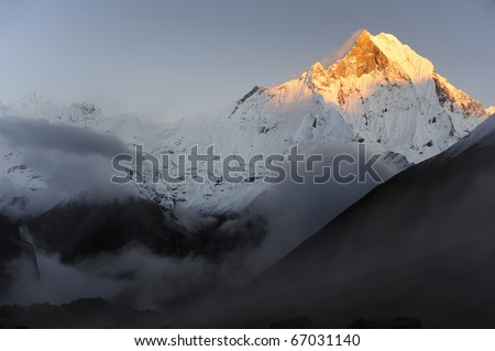 Machhaphuchhare  (Fish Tail), is a mountain in the Annapurna Himal of north central Nepal. It is revered by the local population as particularly sacred to the god Shiva. - stock photo