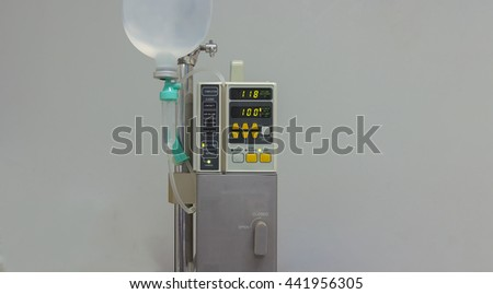 Machine control dripping of saline solution to patient and medical equipments - stock photo