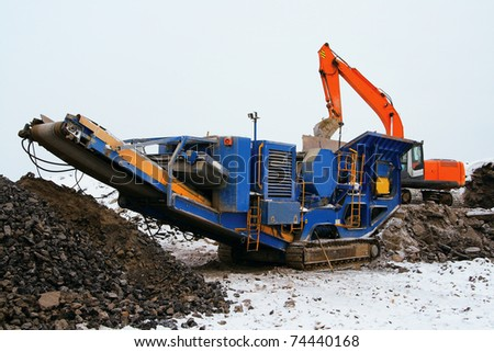 Machine for crushing stone construction waste - stock photo