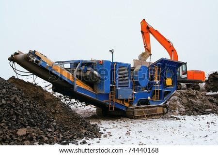 Machine for crushing stone construction waste - stock photo