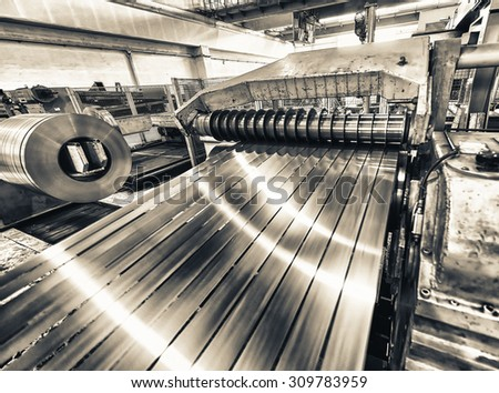 Machine for cutting steel coils. - stock photo