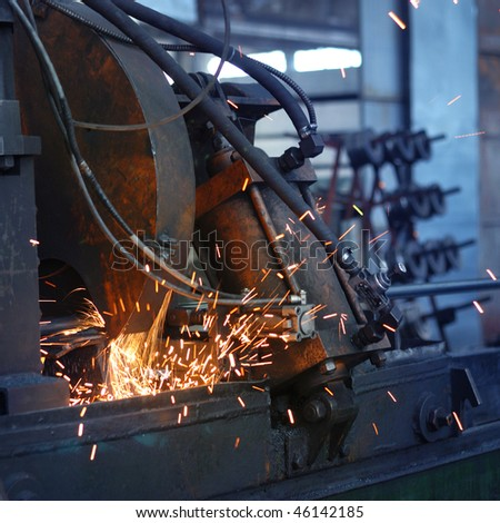 machine for grinding/cutting metal and sparks spreading - stock photo